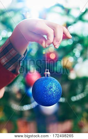 Children's Hand With Blue Christmas Toy Ball