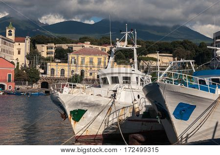 boats in the Harbor, against the backdrop of mount Vesuvius. Naples, Italy