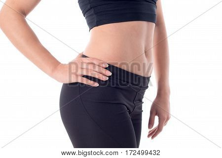 Beautiful sport belly of a young girl who is holding his hand at his side
