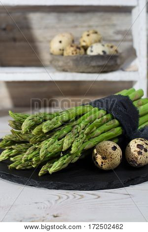 Spring season diet meal - fresh green asparagus and quail eggs
