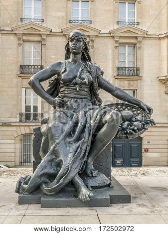 PARIS, FRANCE - 25 AUGUST, 2013 - One of six statues representing six continents - Africa, outside of d'Orsay Museum, Paris, France