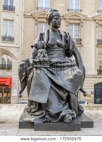 PARIS, FRANCE - 25 AUGUST, 2013 - One of six statues representing six continents - Asia, outside of d'Orsay Museum, Paris, France