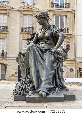 PARIS, FRANCE - 25 AUGUST, 2013 - One of six statues representing six continents - South America, outside of d'Orsay Museum, Paris, France