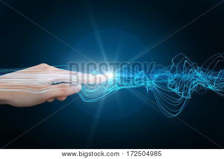 Hand pointing against futuristic glowing lines on black and blue background