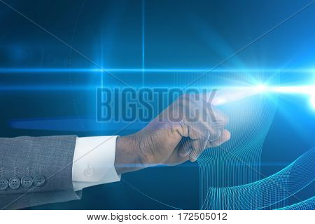 Businessman hand pointing finger against futuristic glowing blue background