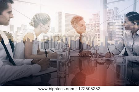 Serious businessman during a meeting talking to his employees in the meeting room