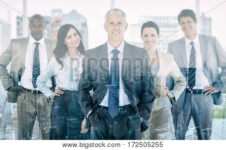 Smiling business team standing upright with their hands on their hips