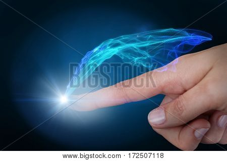 Human hand pointing against blue glowing black background