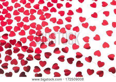 Valentines day pattern of red hearts confetti on white background. Festive Valentine.
