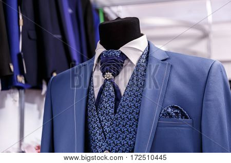 Wedding mens suits in wedding shop on mannequins