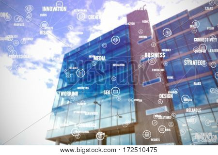 Sphere of icons and words against low angle view of office building