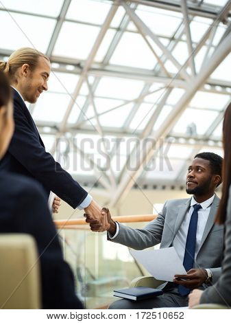 Business leader welcoming new manager