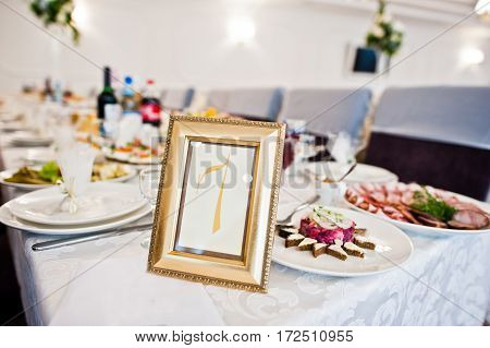 Number 7 In The Frame At Guest Table On Wedding Reception.