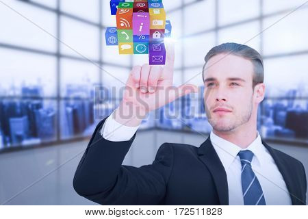 Attentively businessman in suit pointing up against room covered with windows
