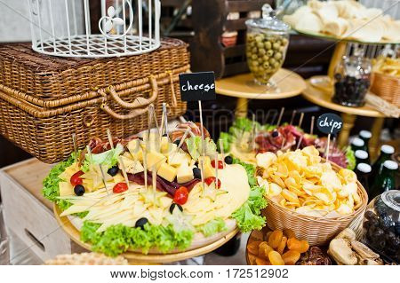 Diferrent Cheese, Chips, Meat And Salads On Wedding Reception.