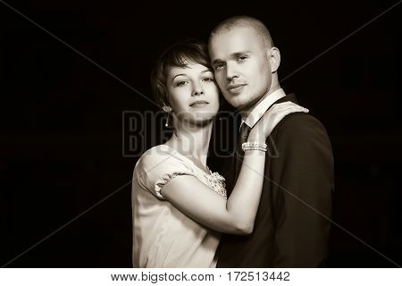 Happy young couple in love. Man and woman on night city street. Stylish fashion model outdoor