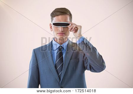 Handsome businessman virtual reality glasses against white background