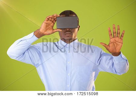 Man with virtual reality headset on white background against green background