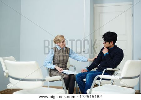 Experienced psychologist expressing her empathy to patient