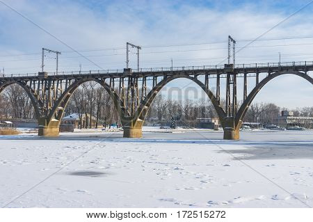 Classical arched bridge over Dnepr river at winter season in Dnepr city Ukraine