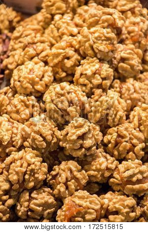 Pile of whole fresh walnuts without nutshells