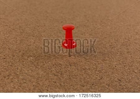 red pin on Cork board texture background.