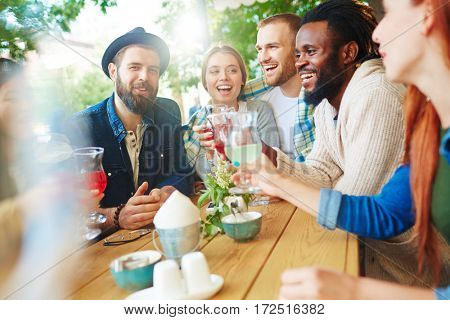 Several buddies spending time with drinks