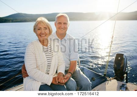 Romantic seniors spending vacation on yacht