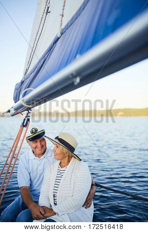 Amorous senior couple enjoying their romantic travel on yacht