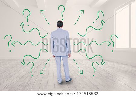 Rear view of businessman walking on white background against bright white room