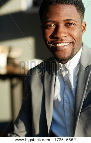 Attractive lawyer with toothy smile looking at camera