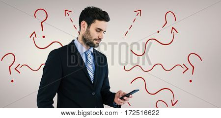 Businessman text messaging on mobile phone against grey vignette