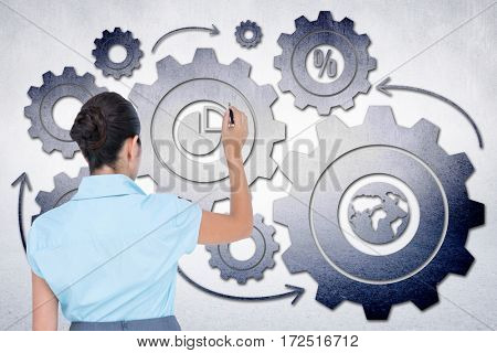 concentrated businessman writing with marker against white wall