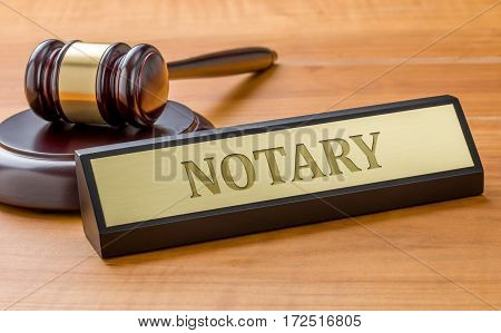 A Gavel And A Name Plate With The Engraving Notary