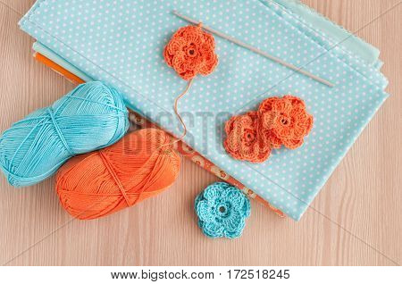 Handmade knitted crochet flowers. Cotton textile for needlework. Top view