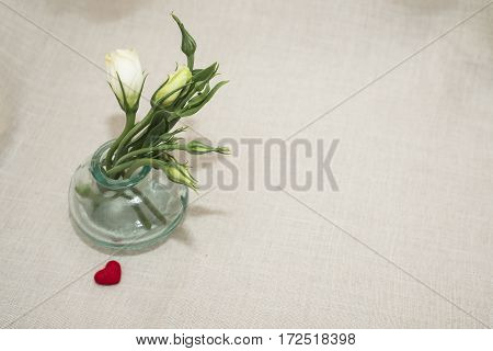 Flowers in a glass vase for your favorite and red heart for her.