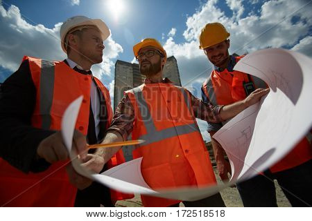 Low angle portrait of three workmen