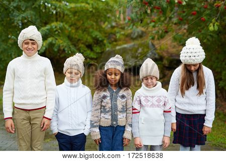 Row of kids with various expressions
