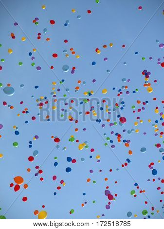Multi colored balloons on a blue sky