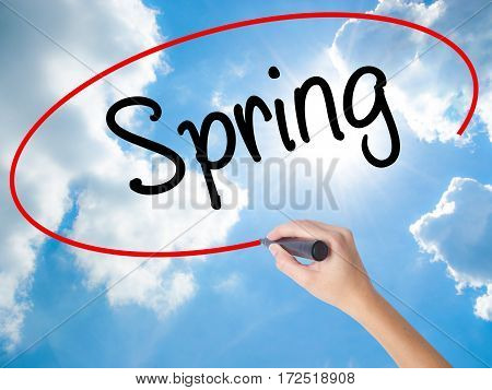 Woman Hand Writing Spring With Black Marker On Visual Screen.