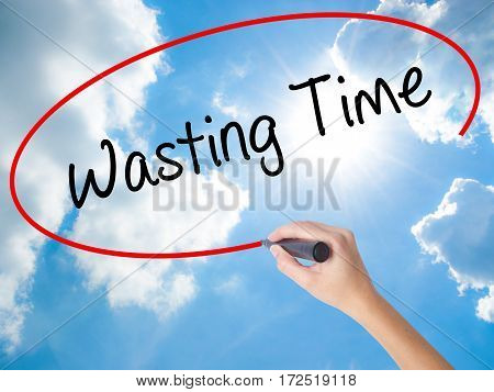Woman Hand Writing Wasting Time With Black Marker On Visual Screen
