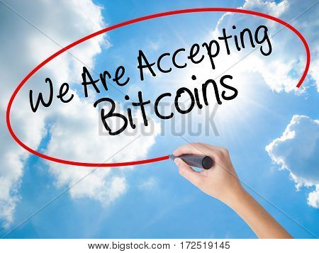 Woman Hand Writing We Are Accepting Bitcoins With Black Marker On Visual Screen