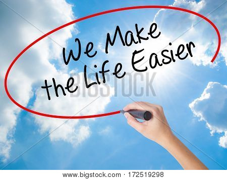 Woman Hand Writing We Make The Life Easier With Black Marker On Visual Screen
