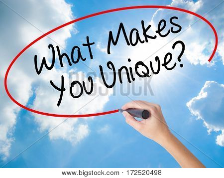 Woman Hand Writing What Makes You Unique? With Black Marker On Visual Screen