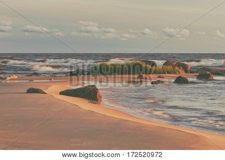 Strong winds on the Baltic sea the oppression of the green cane waves and white clouds