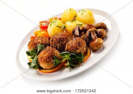 Roast meatballs and vegetables