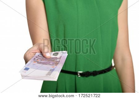 Woman in a green dress holding money