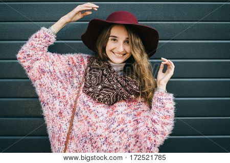 Beautiful Smiling Happy Woman In Hat. Retro Fashion. Summer Hat With Large Brim Over Dark Blue Backg