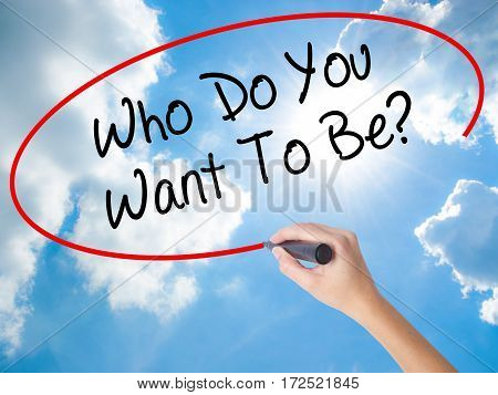 Woman Hand Writing Who Do You Want To Be? With Black Marker On Visual Screen