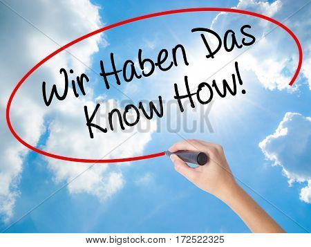 Woman Hand Writing Wir Haben Das Know How! (we Have The Know-how In German)  With Black Marker On Vi
